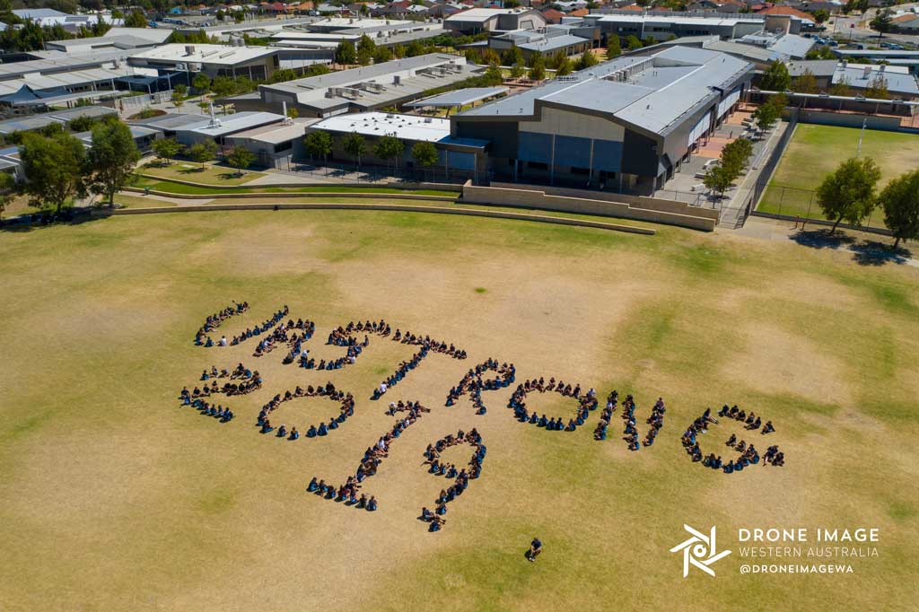 DroneImageWA-ButlerCollege-urstrong-2019-people-formation-words